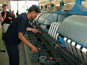 Photo: observing worker at silk factory, Pak Thong Chai