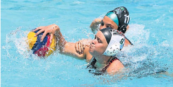 Alexander Road's Shaylin Whitlock, front, is challenged by Alexa-Rose Bataille of Pearson in the Girls' Water Polo Tournament at Alexander Road at the weekend