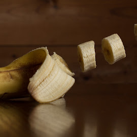 Floating Banana by Michelle Eagan - Food & Drink Fruits & Vegetables ( pieces, banana, fruit, levitation, fresh, separation, floating, four, cut, yellow )