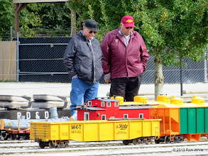 Photo: Gary Brothers and Jerry Schoenberg looking at the yellow three dome tank car that Gary built for Jerry.      HALS / SWLS 2013-1108  RPW
