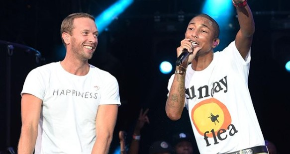 Chris Martin, left, with Pharrell Williams at the Global Citizen Festival at FNB Stadium on Sunday, December 2.