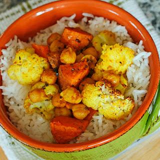 Roasted Cauliflower, Sweet Potatoes and Garbanzo Beans Over Rice.