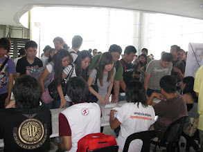 Photo: Registration table gets mobbed.