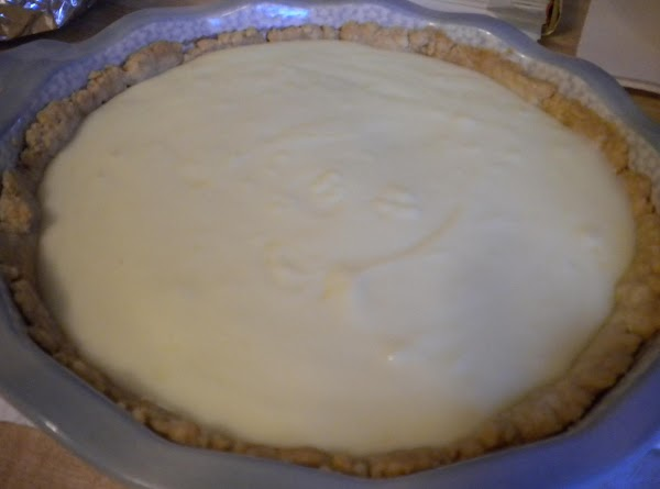 Spread 2/3 cup of peanut butter crumbs in the baked and cooled pie shell,...