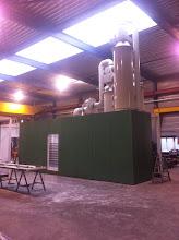 Photo: Ammoniakstripper in container voor BTS Italië