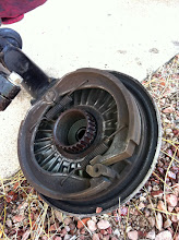 Photo: Final drive with good splines and very dirty, contaminated brake shoes.