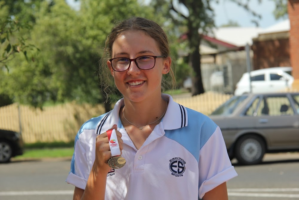 Bella Stewart with her national champs gold medal