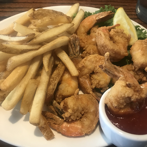 Fried shrimp and fries with cocktail sauce