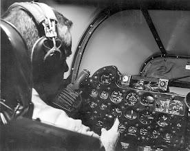 Photo: LT B.G. Duke, takes a simulated flight in a F3D-2T2/15V5 operational flight trainer.
