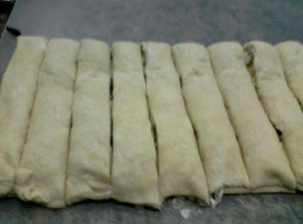 Cut 18 strips cross wise through the dough.