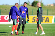 Bafana Bafana goalkeeper Itumeleng Khune (L) and Ronwen Williams (C) in a discussion with goalkeeper coach Lee Baxter (R) during the South Africa training session at Princess Magogo Stadium on September 3 2018.
