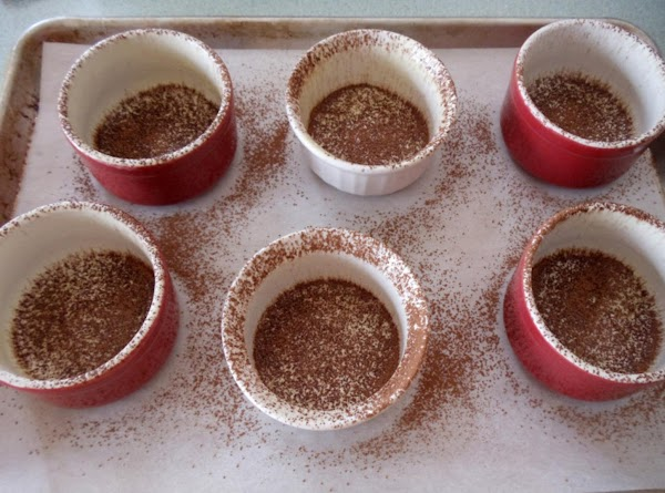 Preheat oven to 425. Grease 6 (6 oz.) custard cups, dust with cocoa powder;...
