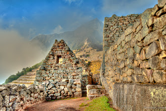 Photo: Through the Ruins  Another from my trip to the glorious and intriguing Machu Picchu. This is taken from inside the ruins, looking up at the Watchman's Hut, which sits in a thin layer of cloud. This is just a few minutes after the sun came up from behind the mountains.  #landscapephotography  #peru  #machupicchu  #tglperu