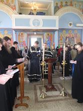 Photo: Священники читают записки