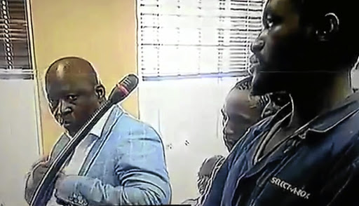 Mike Mangena and his co-accused in court.