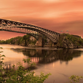 Reversing Falls, New Brunswick by Sue Connor - Buildings & Architecture Bridges & Suspended Structures ( falls, canada, reversing falls, new brunswick, sunset, river, water )