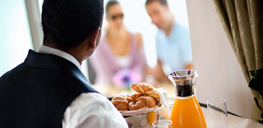 celebrity-suite-class-butler.jpg - Butler service is part of what Suite Class guests receive on a Celebrity Cruises vacation.