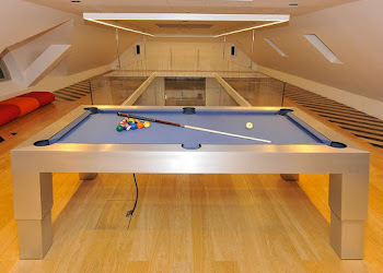 The apex pneumatic pool table in a loft with wooden flooring