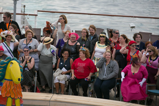 International Women's Day.jpg - Several dozen women gathered on the aft deck for a group photo in honor of International Women's Day.