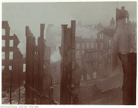 Photo: Bay St. looking SW. The extent of the fire damage as seen from an upper storey in the Telegram building, facing south-west. One of the towers of the 2nd Union Station may be seen in the background, right. [This photo is from the same place as the previous photo, only turned slightly eastwards. Note the 'Comfort Soap' fragment at right]