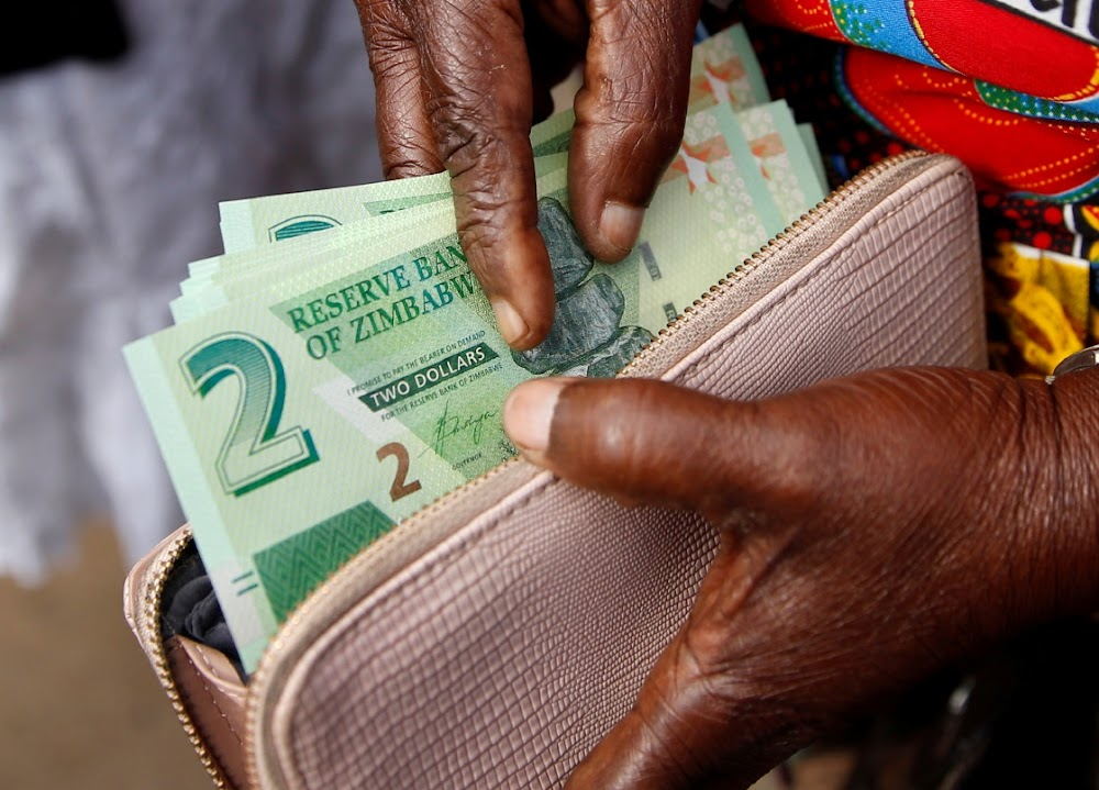 Two Zimbabwe banks investigated for diverting new notes to black market
