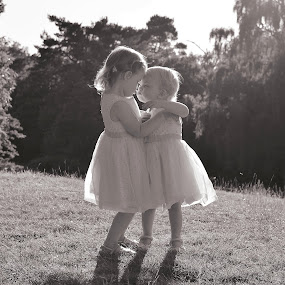 Sisters forever by Vix Paine - Babies & Children Toddlers ( love, child, sister, kiss, sisters, location, family, sunglare, toddler, portrait,  )