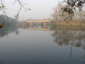 """Photo: Famous """"Darbesh Pool"""" across from """"Bandhukunda"""" (Prabhu's swimming pond where He used to float in His crossed-legged lotus-seat position) on Jessore Road. While crossing this bridge with devotees, he stopped by the present Sri-Angan location and later founded Sri-Angan there."""