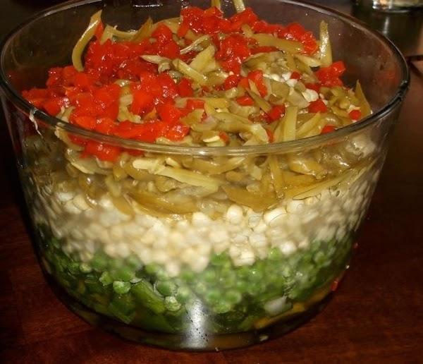 In a medium saucepan add sugar, apple cider vinegar, and oil.  Bring to...