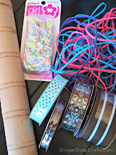 Photo: Here are the supplies I used: paper towel roll, rubber bands & ribbon.