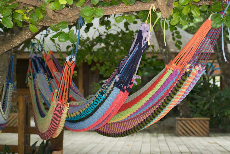 Kick back and pull up a hammock on Roatan Island in Honduras during your afternoon shore excursion.