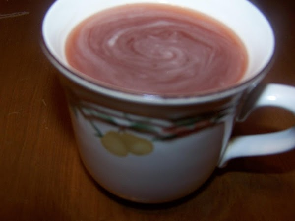 Pour boiling water into cup and stir well until candies are dissolved.  Add...
