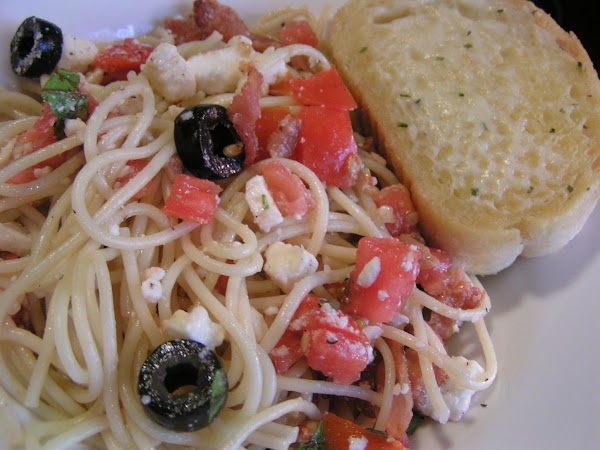 Place pasta in large bowl; top with tomato mixture.  Sprinkle feta, black olives...
