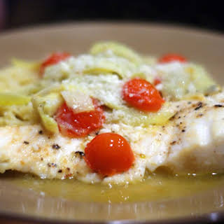 Baked Halibut with Artichokes & Tomatoes in a White Wine Sauce.