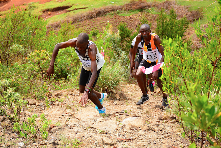 Athletes manoeuvre a rocky section during the Athletics Kenya Mountain Running Championships in Naivasha