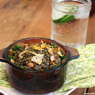 French Lentils du Puy with Caramelized Onions & Pistachios on a bed of Sautéed Kale