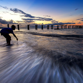 The Picker by Raffy Nadayag - Landscapes Sunsets & Sunrises ( old pier, water streak, seashore, sunset, pier, ruins, seascape, landscape,  )