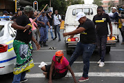 This image of Olivia Makete being kicked by an ANC official outside Luthuli House on Monday sparked widespread anger.
