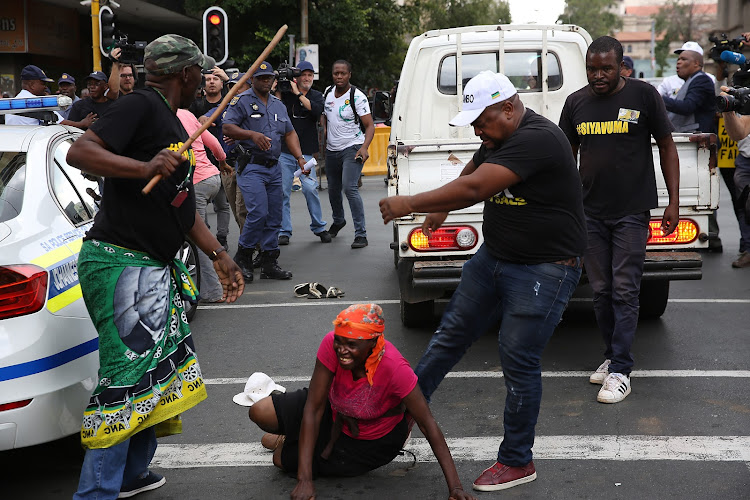 ANC supporters attack a bakkie suspected to be carrying BLF members, outside Luthuli House in Johannesburg on 5 February 2018.