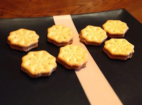 First thing first. You need to make 'sandwiches' with the Ritz crackers. You need...