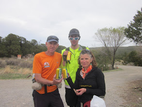 Photo: Now we're down at the Cedro Peaks aid station enjoying some brats and beer. Deb is eating a hamburger and is a vegan ;-) Steve, Kevin and Deb...