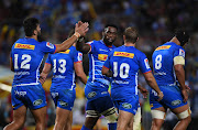 The DHL Stormers captain Siya Kolisi and his teammates celebrate Damian de Allende try during their Super Rugby match against the Jaguares at Newlands in Cape Town on March 15 2019.