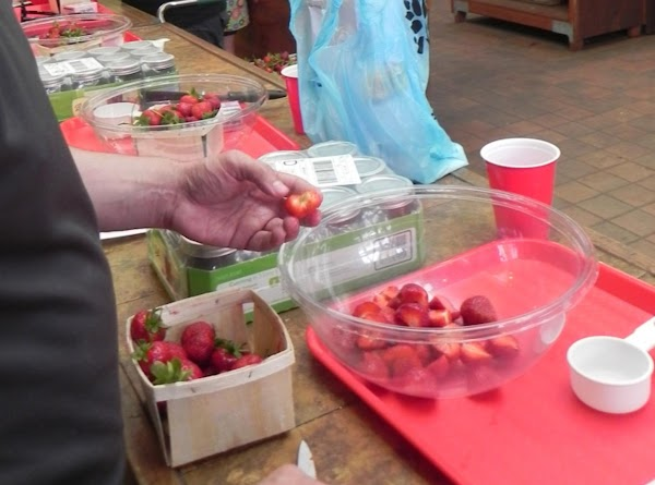 Wash your strawberries and cut stems off and then slice your strawberries as they...