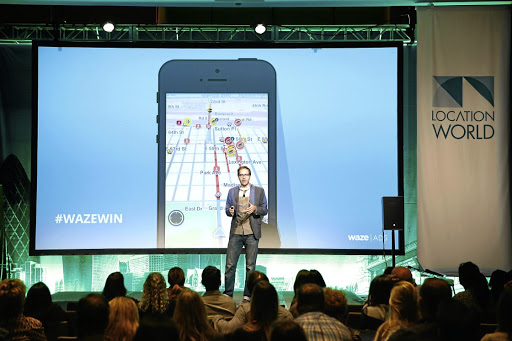 Leading: A Waze product specialist speaks at LocationWorld 2016 in New York. Google bought Waze, a mapping and navigation company, in 2013. Picture: BRIAN ACH/GETTY IMAGES