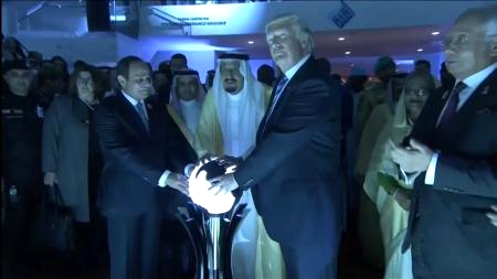 US President Donald Trump places his hands on a glowing orb as he tours with other leaders the Global Center for Combating Extremist Ideology in Riyadh, Saudi Arabia. Picture: SAUDI TV VIA REUTERS