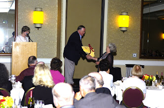 Photo: David Gilmour presenting award to Carol Carr Mayo for being married the longest