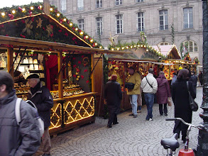 Photo: One of the Christmas markets surrounds the Cathedral in small wooden shops like these. The market is more a German tradition than a French one, and so Strasbourg is home to the largest one in France.