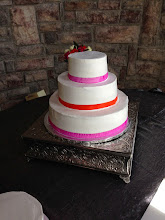 Photo: Spring wedding cake: totally smooth w/hot pink & orange alternating ribbon wrap. (View before fresh flowers.)