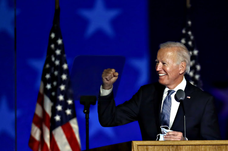 Democratic presidential nominee Joe Biden gestures during an election party in Wilmington, Delaware on November 4 2020. Picture: BLOOMBERG/STEFANI REYNOLDS