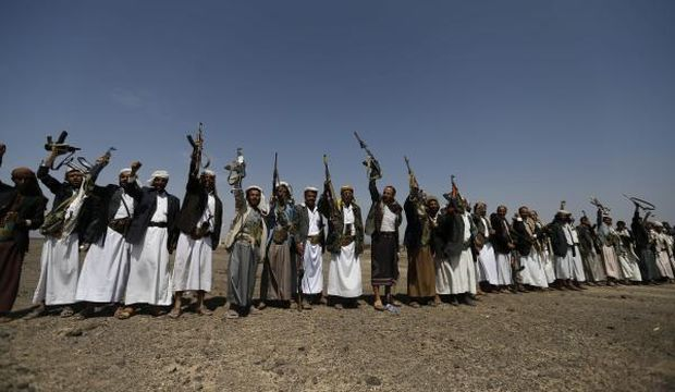 Followers of the Shi'ite Muslim Houthi group shout slogans as they attend an anti-government gathering in Arhab, north of Yemen's capital Sana'a, on August 17, 2014. (Reuters/Khaled Abdullah)