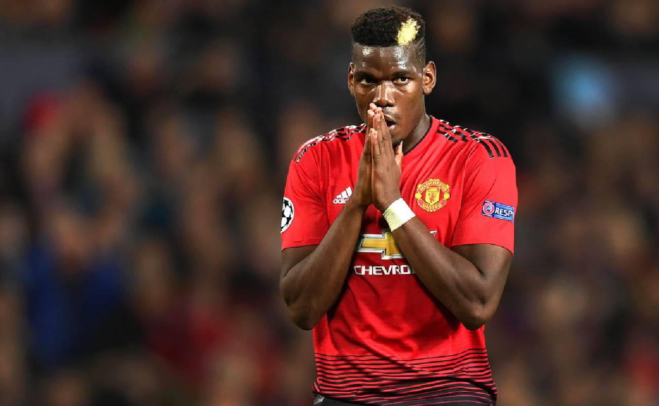 Alt: Paul Pogba of Manchester United holds his hands in front of his mouth after missing a goal - Photo by Michael Regan/Getty Images